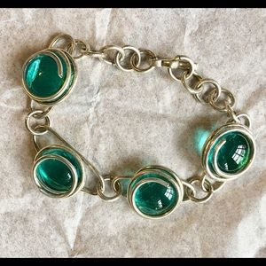 Handmade silver bracelet with green settings